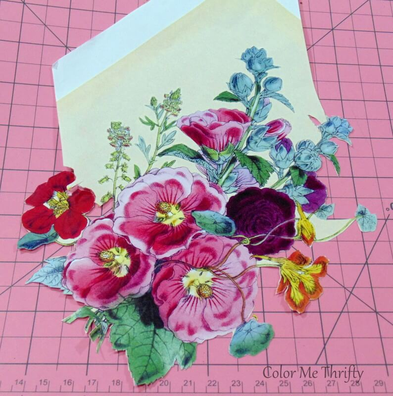 cutting out vintage floral graphic with xacto knife 2