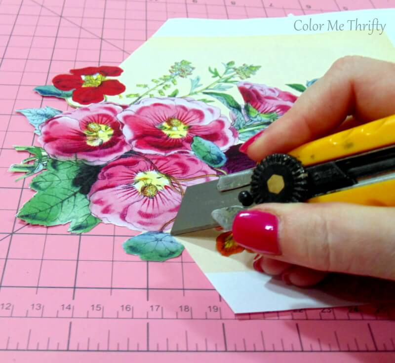 cutting out vintage floral graphic with xacto knife