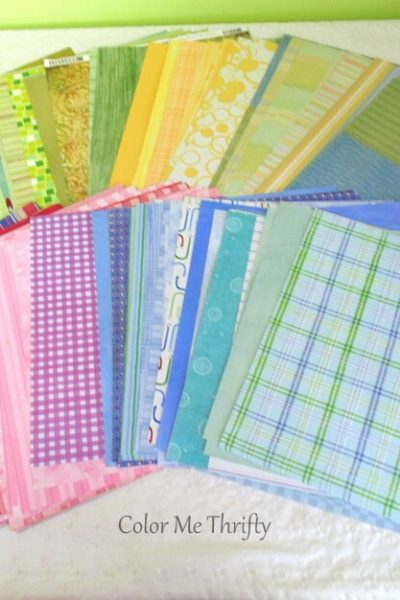 large lot of thrifted scrapbook papers