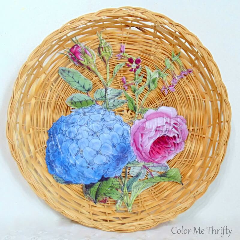 repurposed wicker plate decoupaged with vintage floral graphic