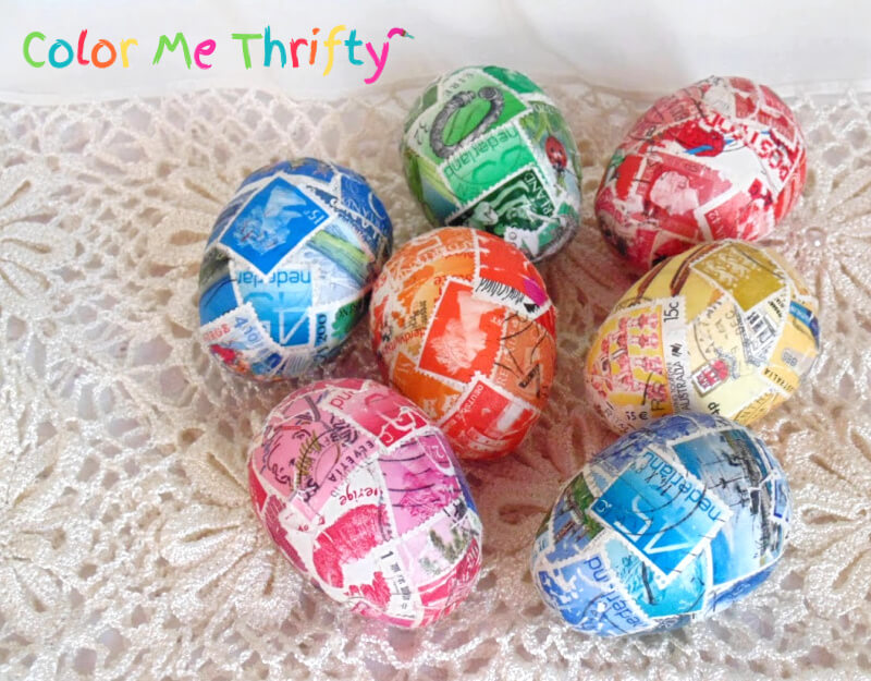 Colorful Easter eggs decoupaged with postage stamps