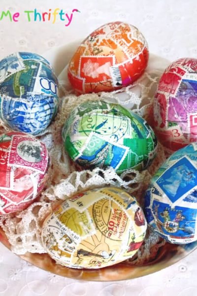DIY decoupaged Easter eggs with colorful postage stamps