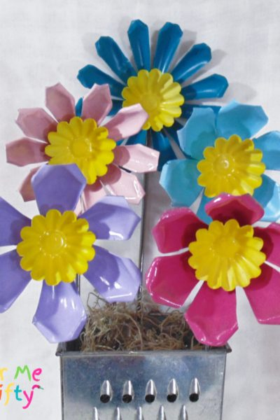 DIY repurposed jello molds made into flowers and spray painted fun colors
