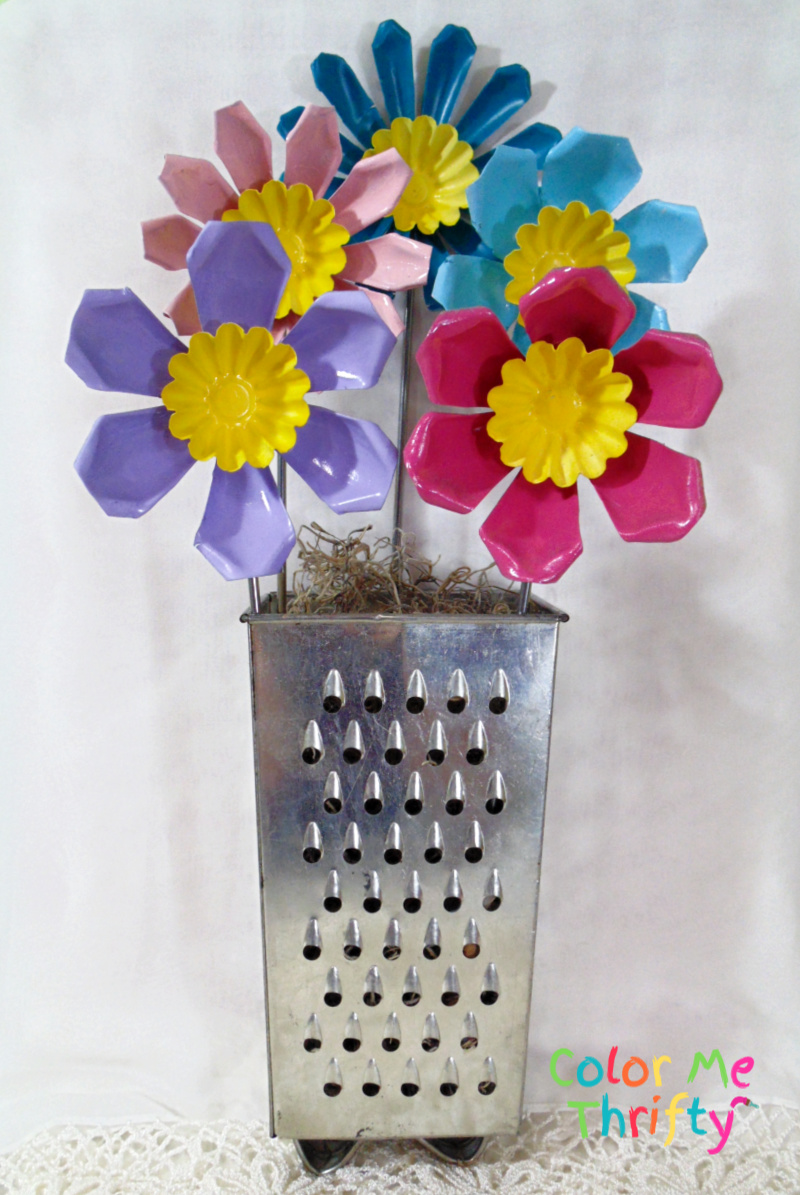 Fun and colorful cut flowers with repurposed jello molds and spray paint
