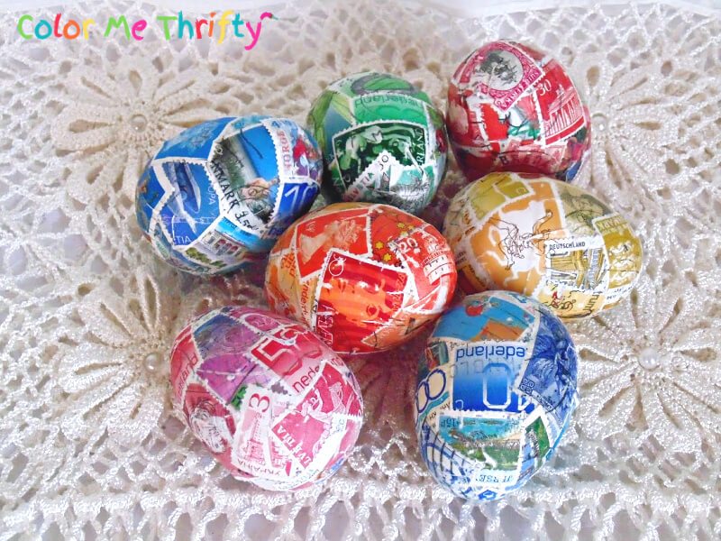 Plastic Easter eggs decoupaged with postage stamps