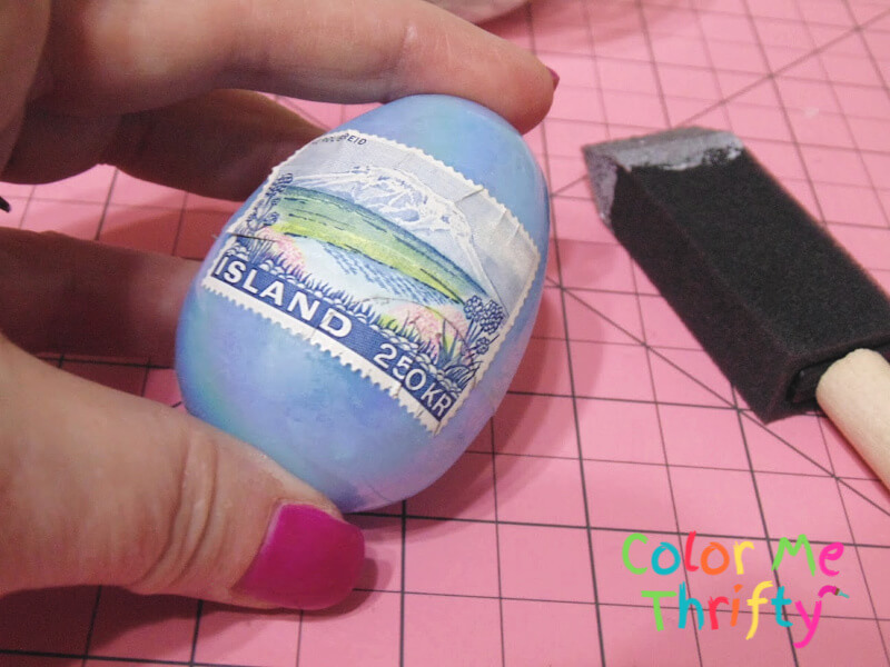 adding postage stamps to plastic Easter egg with decoupage medium
