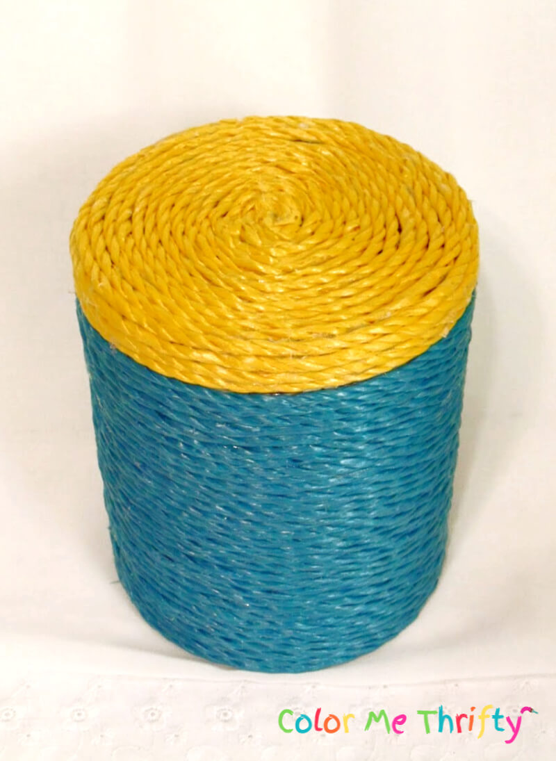 canister lid covered with plastic yellow woven rope