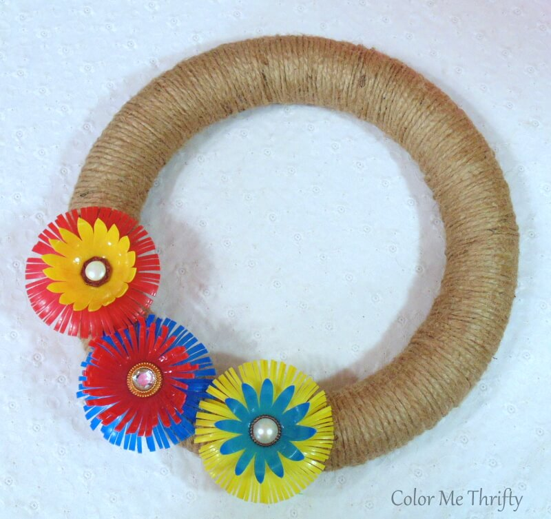 colorful diy plastic flowers created from repurposed plastic balls on jute wreath