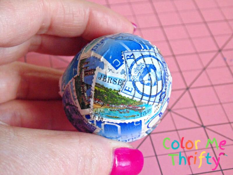 colorful postage stamps decoupaged onto plastic Easter egg