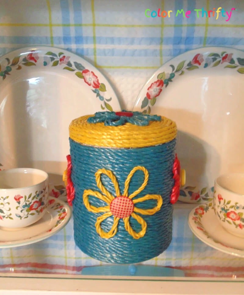colorful rope covered metal canister makeover with diy rope flowers