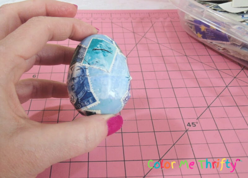 decoupaging plastic Easter eggs with postage stamps