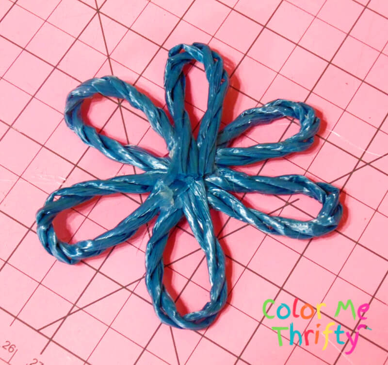 flower created with hot glue and plastic blue woven rope