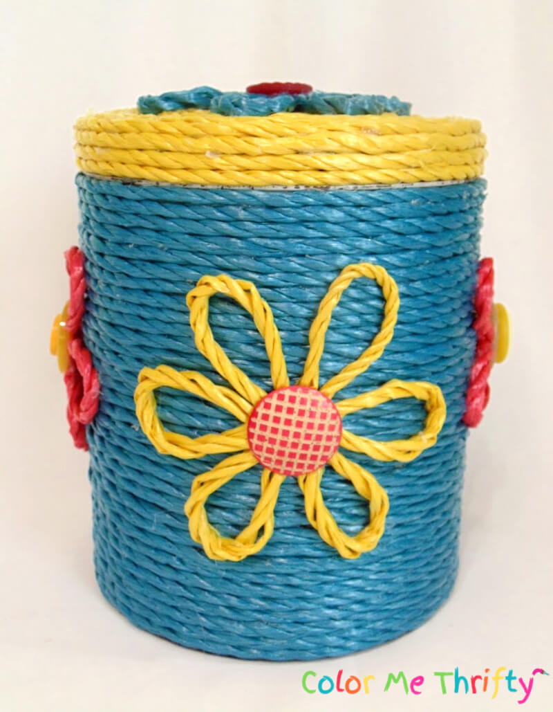 front of metal canister makeover with yellow rope flower