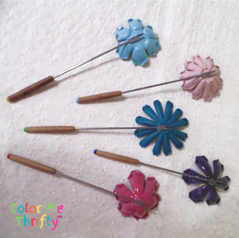 gluing fondue fork stems onto backs of metal flowers
