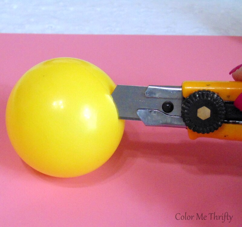 making a slit at seam of plastic ball to start cutting