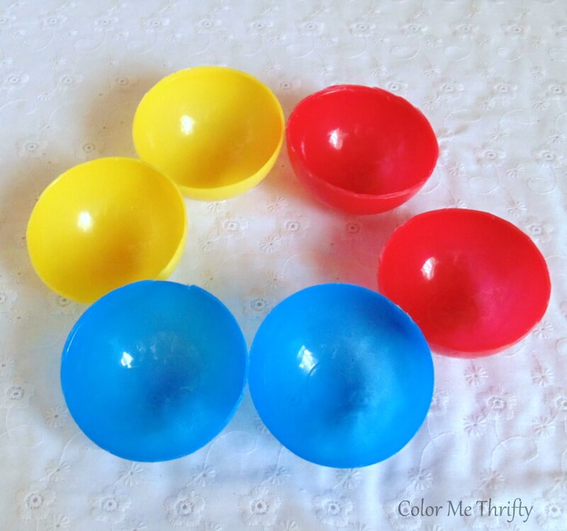 red yellow and blue plastic balls cut in half