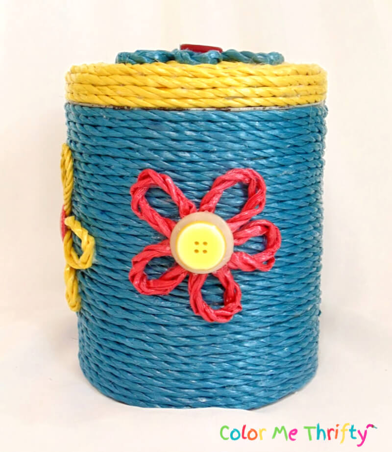 side of metal canister makeover with red rope flower 2