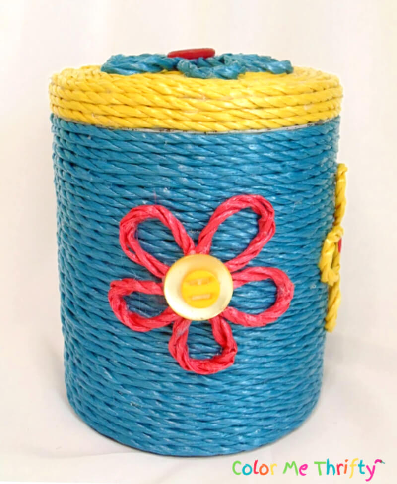 side of metal canister makeover with red rope flower