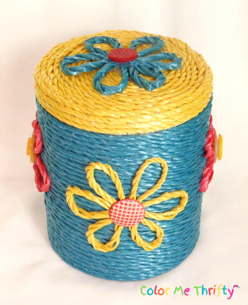 top view of metal canister makeover with colorful rope flowers