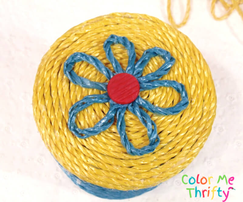 woven rope flower glued onto top of canister lid