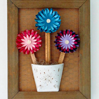 DIY Repurposed plastic balls into fun and colorful flowers wall art