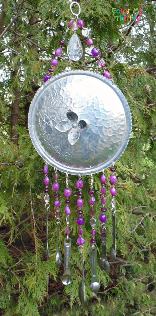 DIY wind chimes from repurposed chafing dish lid and measuring spoons