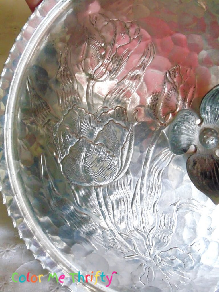 Etched floral pattern on aluminum chafing dish lid
