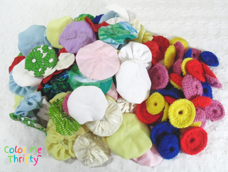 assorted fabric and knitted yoyos for wreath