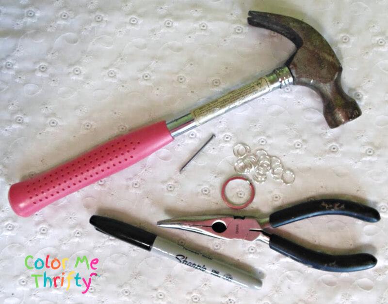 hammer, pliers, black sharpie, split rings, and nail supplies