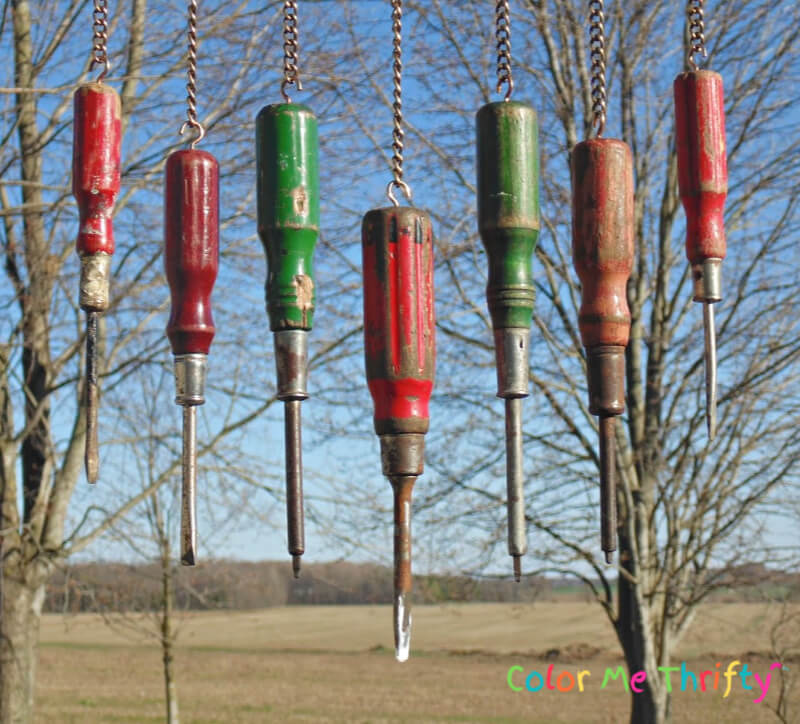 close up of wooden screwdrivers repurposed in diy wind chime