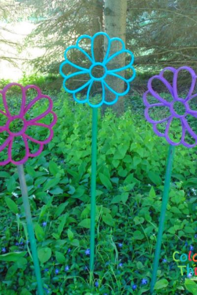 DIY garden art flowers made from repurposed flower-shaped scarf holders