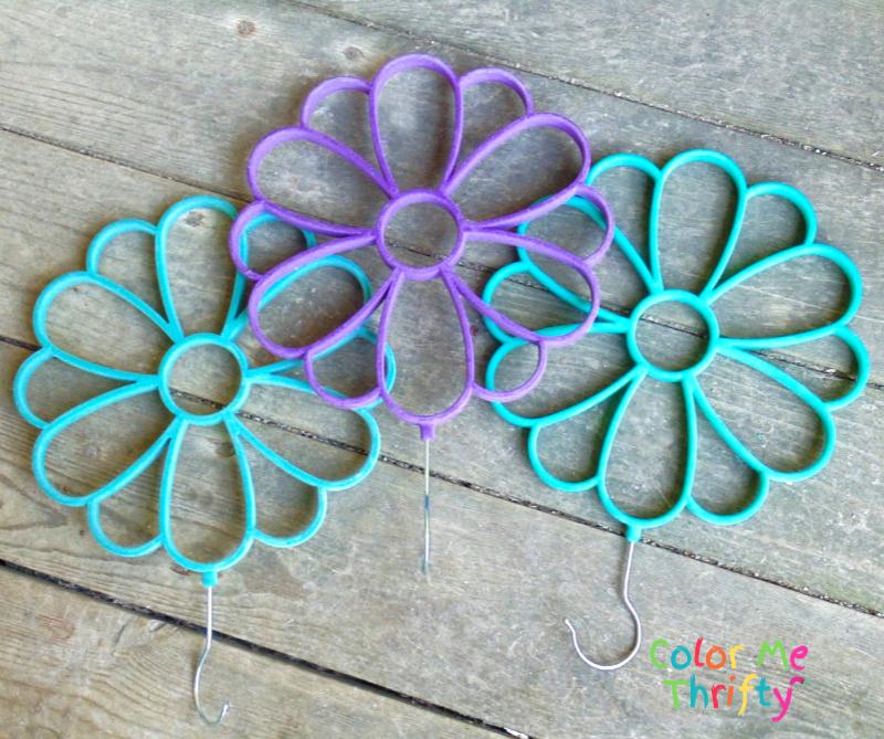 Repurposed scarf holders into DIY garden flowers
