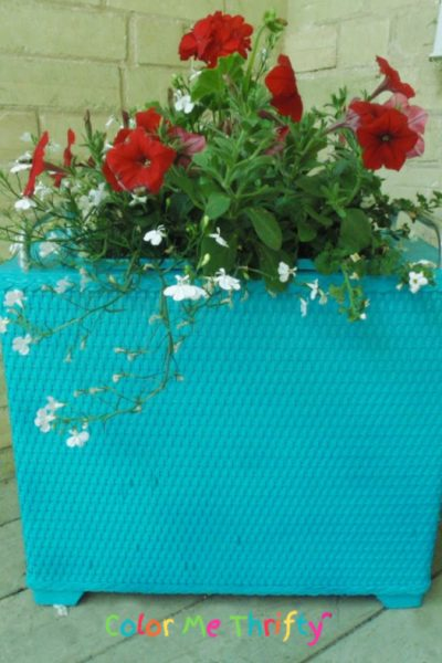 Spray painted and repurposed laundry hamper planter