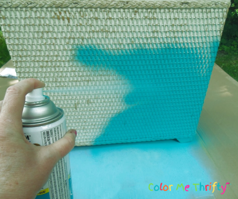 spray painting white wicker laundry hamper aqua blue