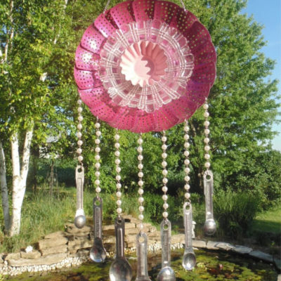 Repurposed metal steamer made into flower wind chime