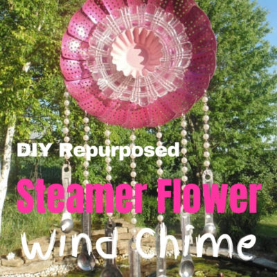 Repurposed metal steamer wind chime that looks like a flower with measuring spoon chimes