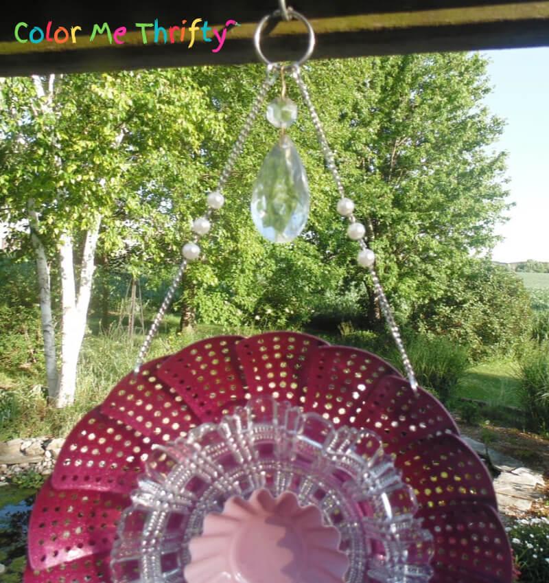 Chandelier crystal added on top of DIY steamer wind chime