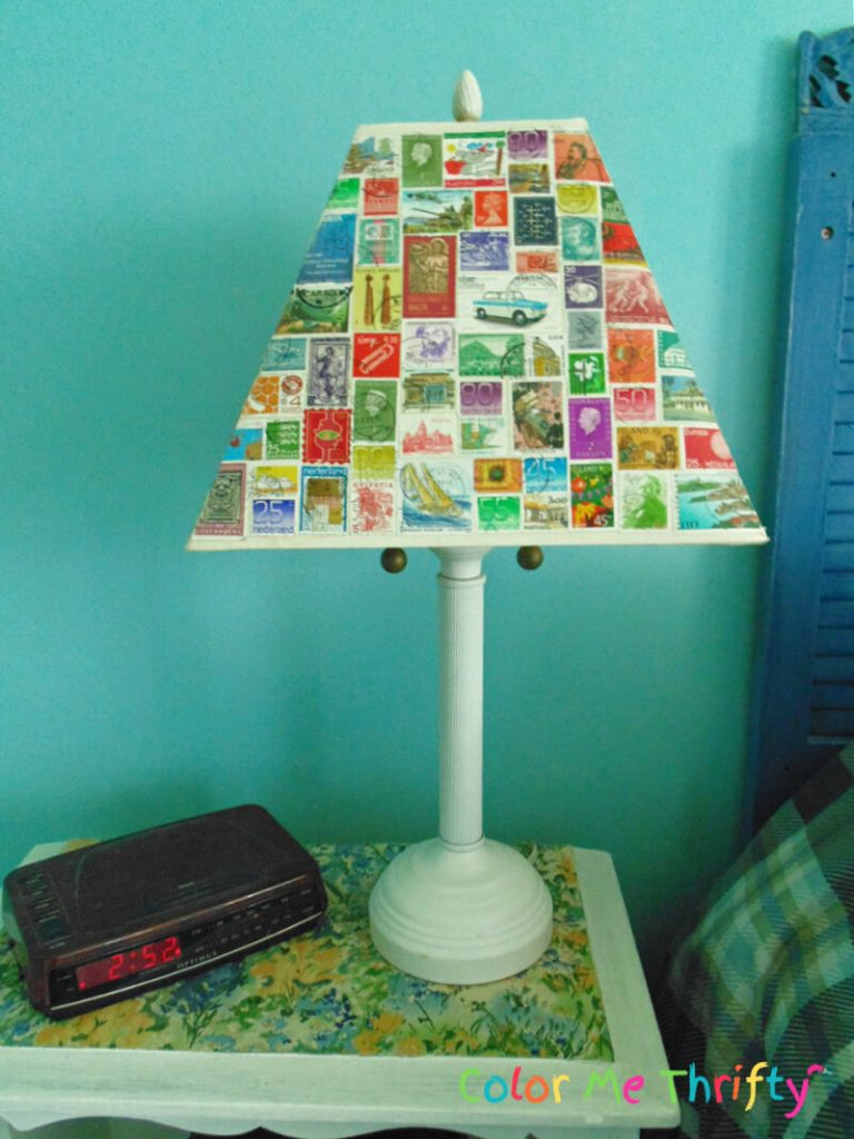front view of decoupaged stamps lampshade makeover