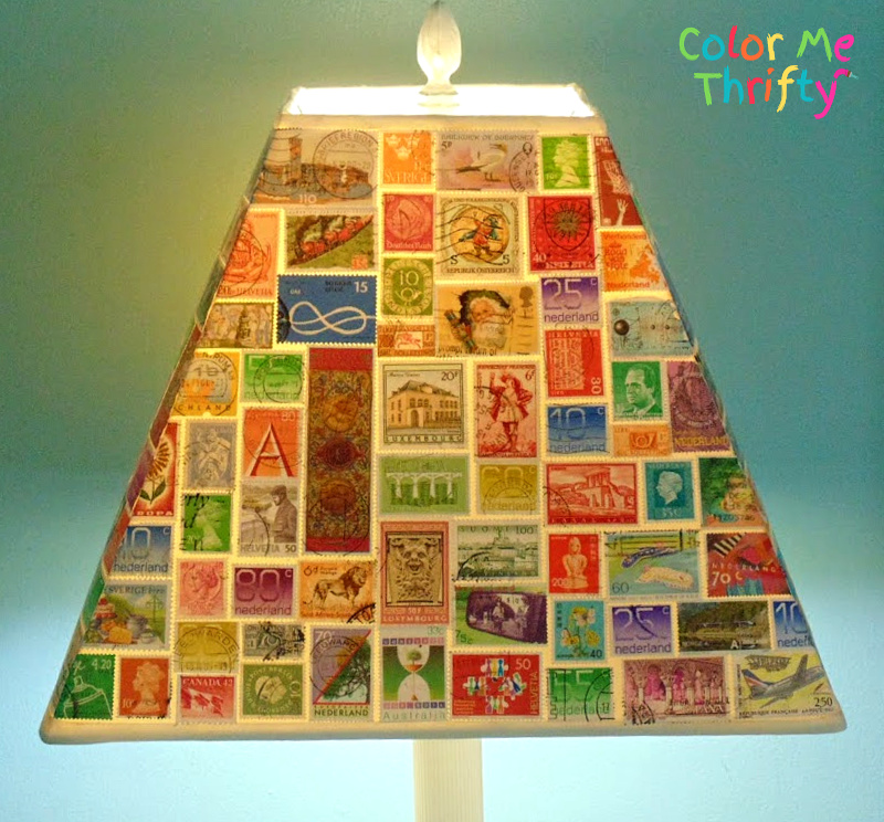 front view of decoupaged stamps lampshade when lit