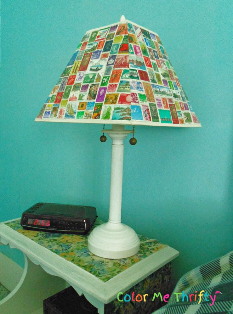 side view of lampshade decoupaged with postage stamps