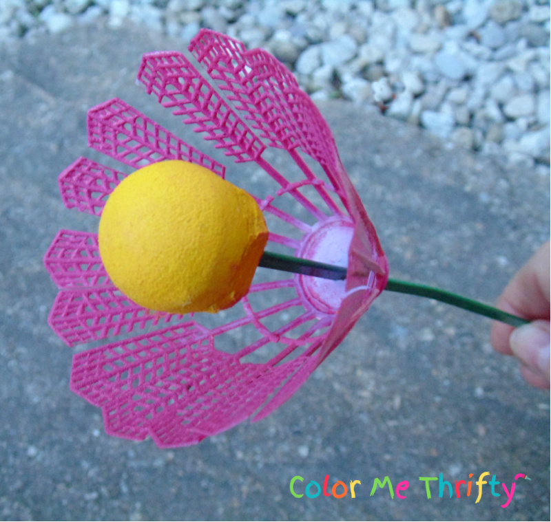 Assembling badminton birdie flowers with skewers as stems