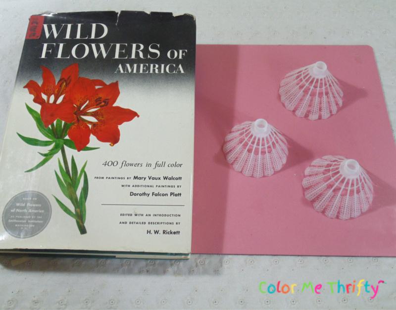placing heavy books on top of badminton birdies to create flowers