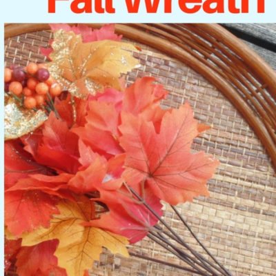 Create a fun and colorful fall wreath for door decor with some fall foliage and flowers and a repurposed wicker tray.