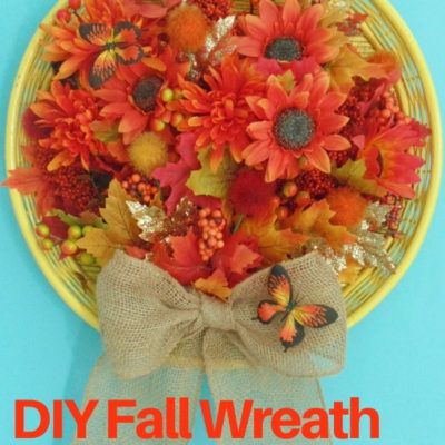 Learn how easy it is to create a fun and colorful fall wreath for door decor with a repurposed wicker tray and some fall foliage and flowers.