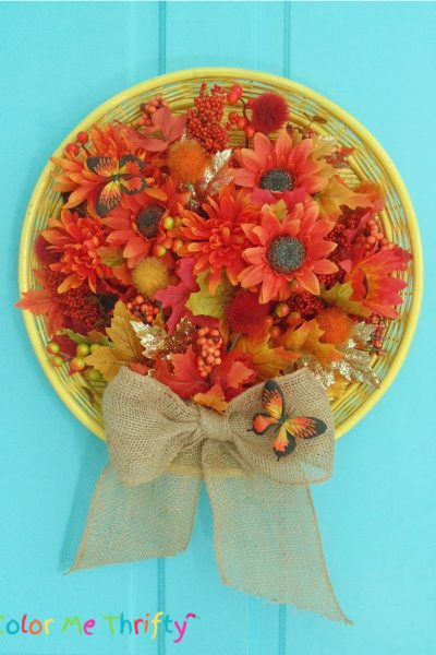 Repurposed wicker tray fall door decor