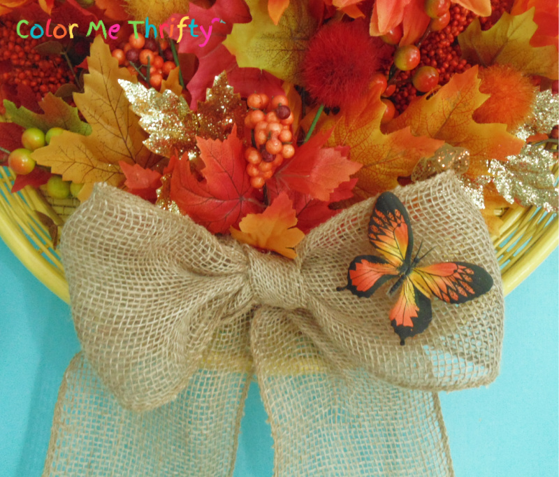 Simple burlap ribbon bow on diy fall wreath with butterfly