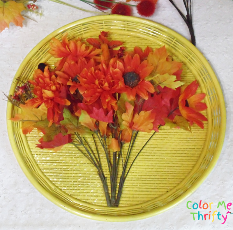 gluing base of fall flowers and leaves onto repurposed tray