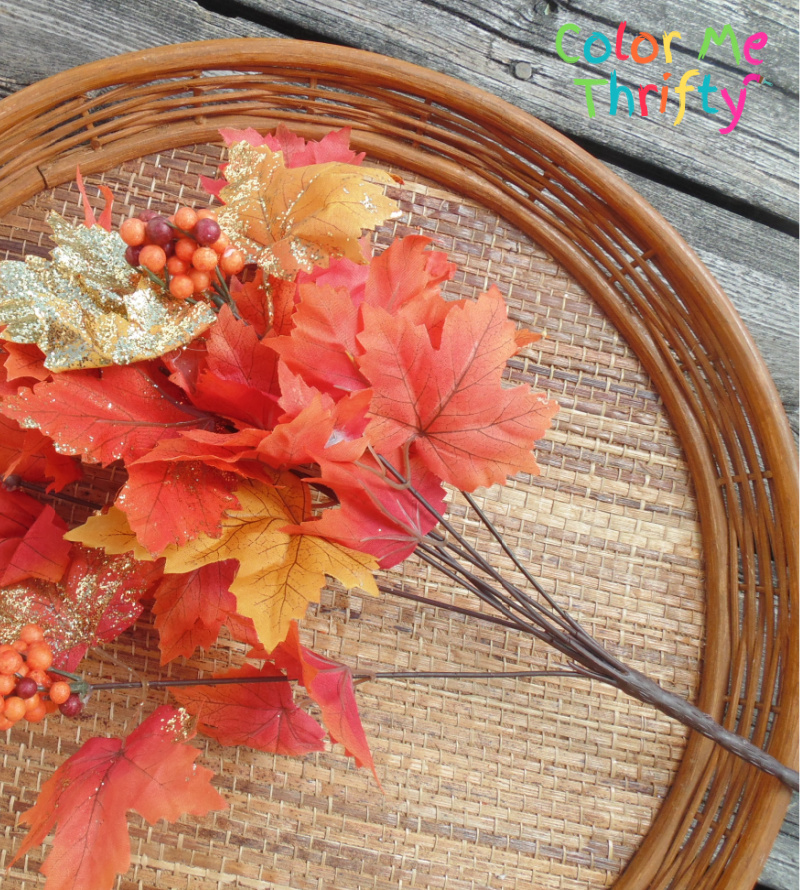 natural wicker tray repurposed into diy fall wreath