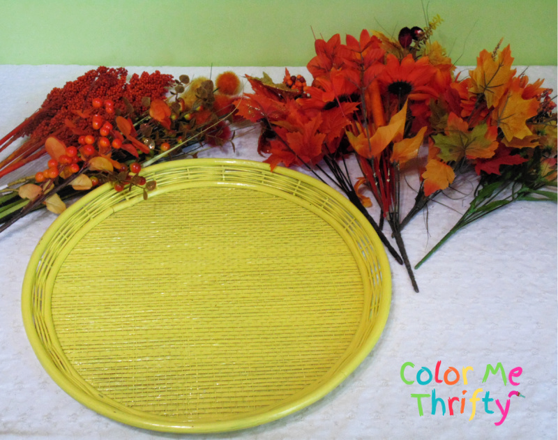 repurposed wicker tray spray painted yellow ready for fall leaves and flowers to be added