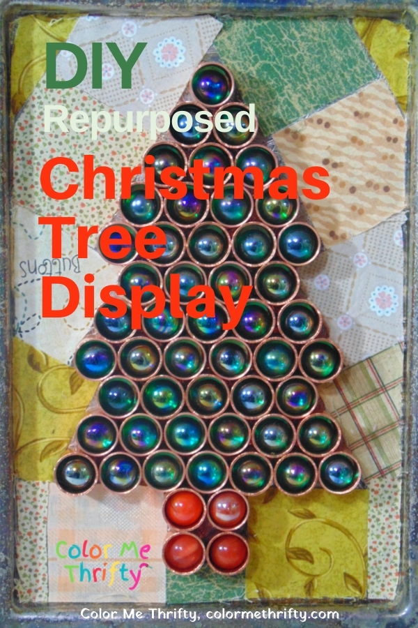 DIY Christmas Tree display created from repurposed copper plumbing caps and marbles